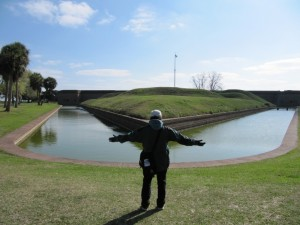 Marianna stands in awe of the moat - Fort Pulaski was one of the only forts we visited that actually had water in the moat.