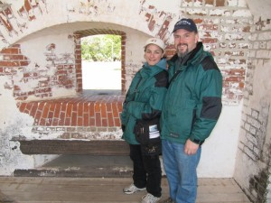 Jason & Marianna in front of a cannon port hole.