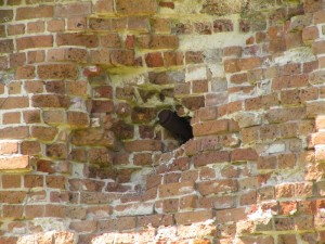 Cannon projectile remains embedded in the wall.