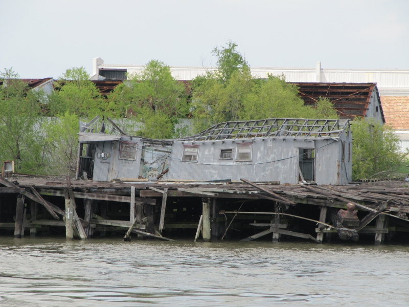 This picture shows that an example of damaged facilities that are still left in ruins. This use to be part of a docking facility. From our camp site we could hear them banging away still making repairs to the levees.