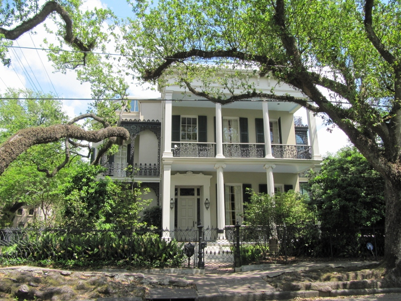 Anne Rice's former home combines both columns and iron work.